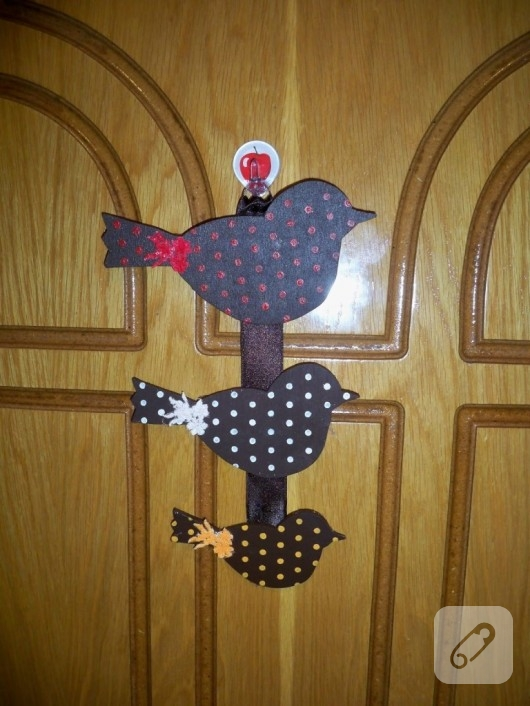 Ahşap kuşlu kapı süsü