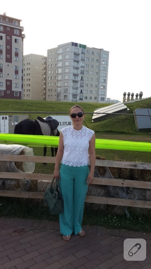 yesil-renkte-bol-paca-kumas-pantolon-modeli