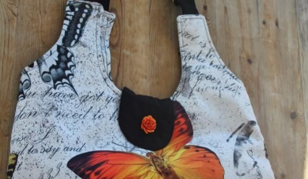 kelebek-desenli-kumas-canta-modeli